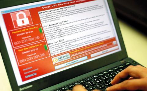 """الكشف تأثير فيروس """"الفدية"""" المصارف 6_125.jpg?itok=cpQvIsok"""