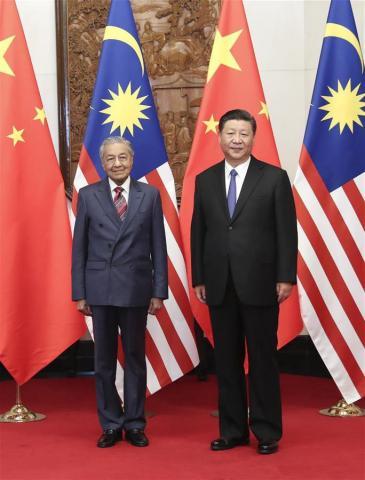 ماليزيا تلغي مشروعات عملاقة الصين DlGO1TJUcAEaEF6.jpg?itok=PJouGZmF